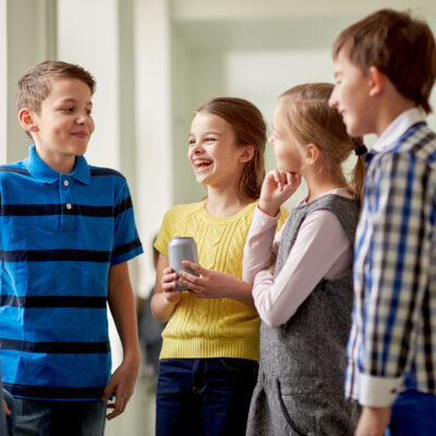 Art of Etiquette for Youth; children laughing together learning etiquette and social skills