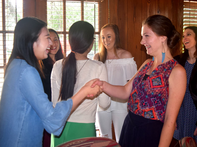 Young women practice introductions and handshaking at Deluxe Life Skills Camp.
