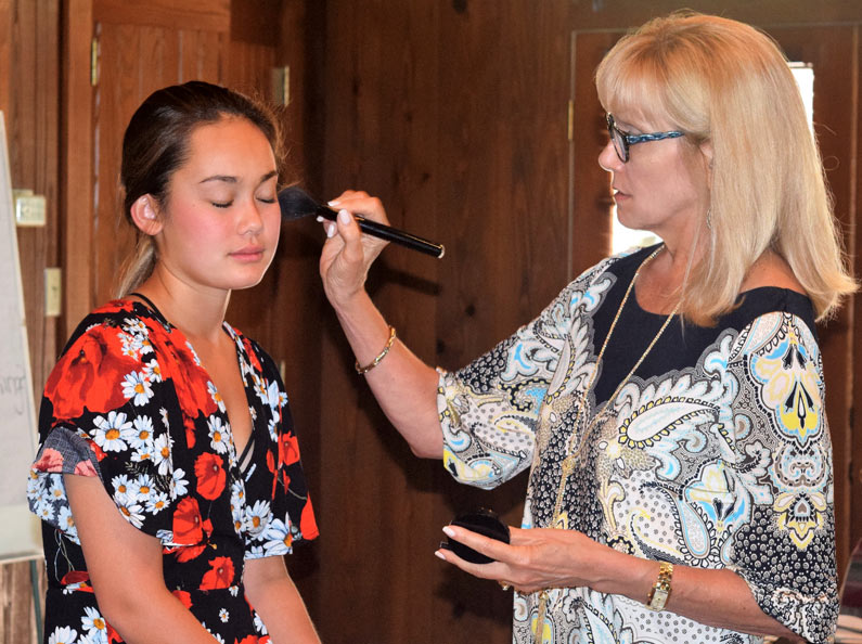 Young women learn make-up techniques at Deluxe Life Skills Camp.