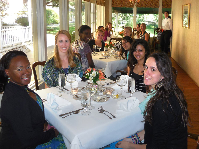 Young women practice dining etiquette at Deluxe Life Skills Camp.